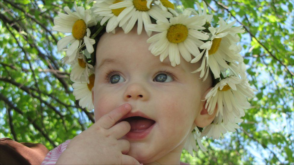 Roslin Claire wearing a garland of flowers