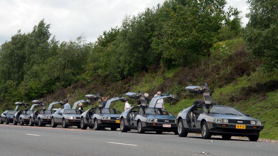De Lorean cars parked in a row
