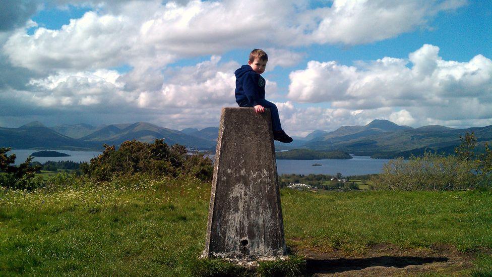 Luke sitting on a pillar at Duncryne