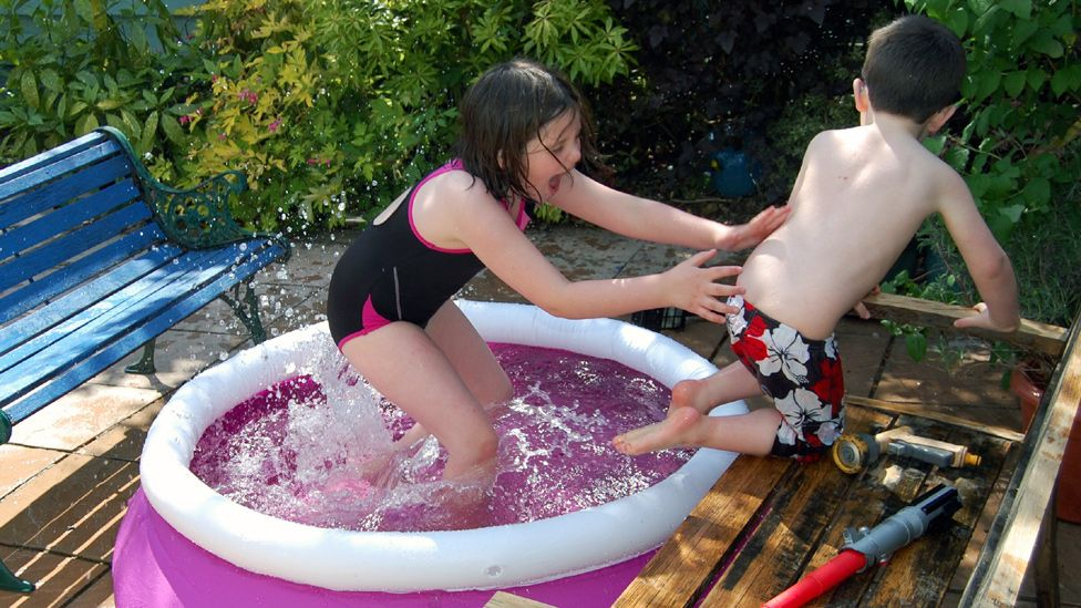Ella and Joe in a swimming pool