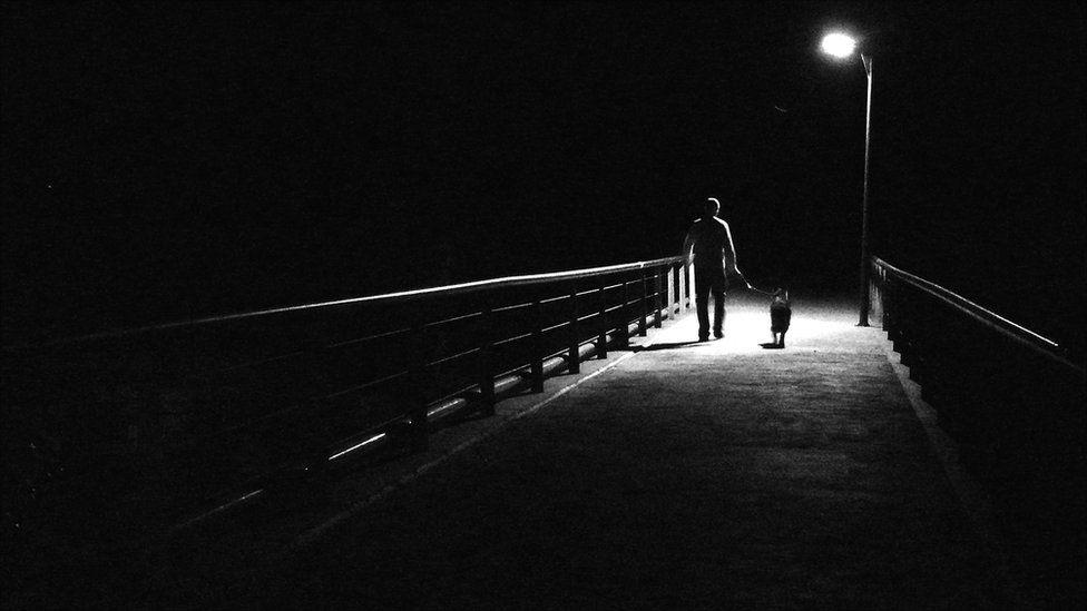 Man and dog on bridge