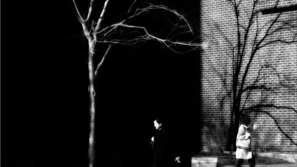 People walking between buildings in Boston, Massachusetts.