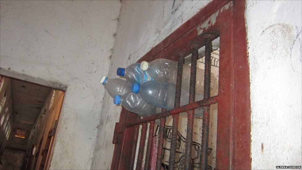 Plastic bottles sticking out of bars in Liberia's Monrovia Central Prison - 2011