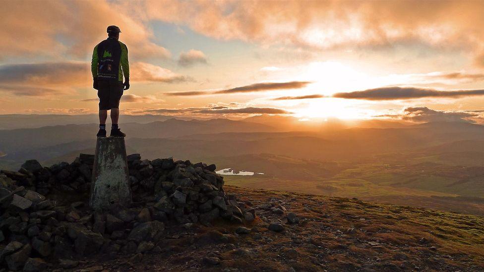 Jonny at the summit of Carn Liath