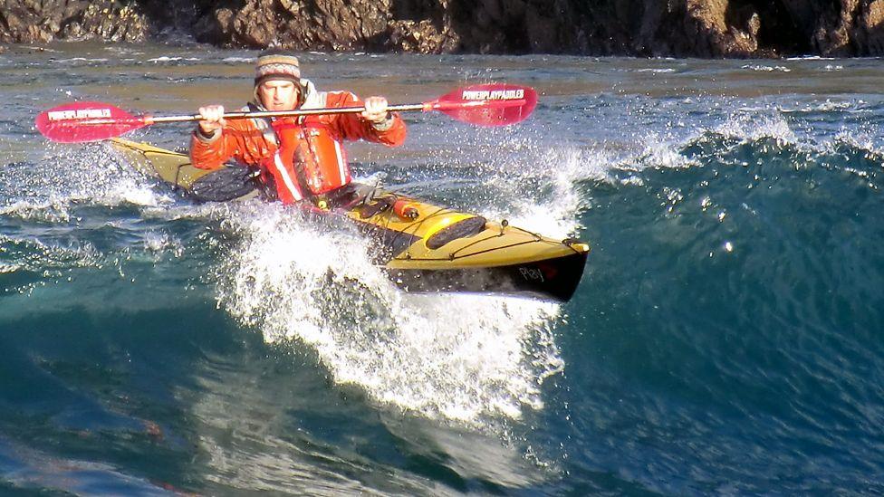 Man in a kayak at sea