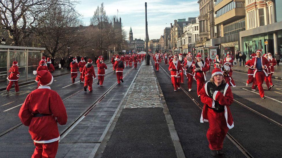 Santa fun run on Princes Street, Edinburgh