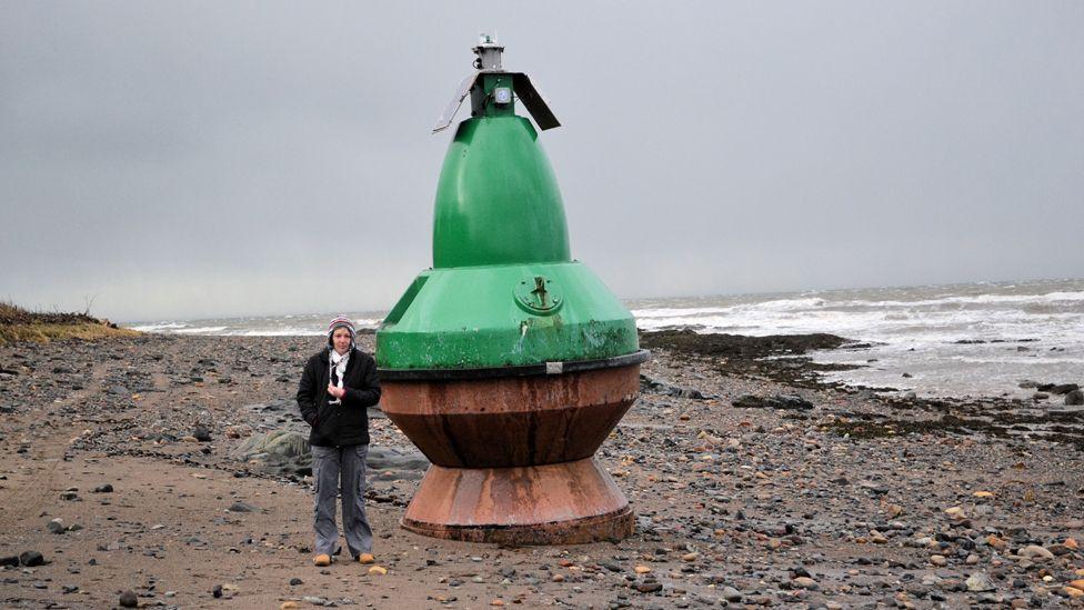 Marine navigation buoy on the beach