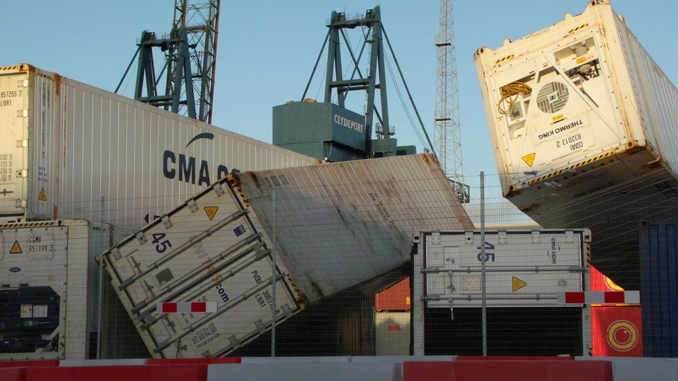 Containers blown over after strong winds