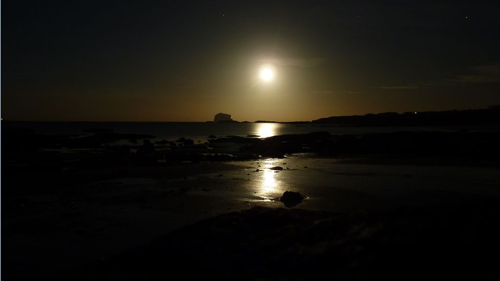 Moon over the Bass Rock