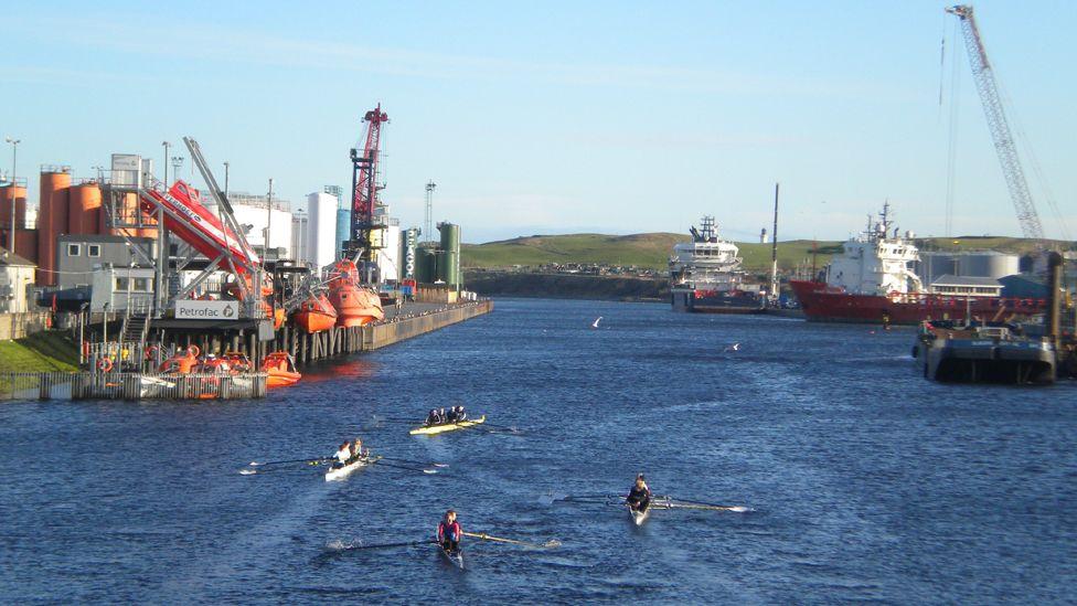 People rowing in Aberdeen harbour