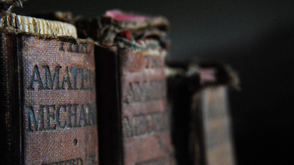 Tatty old books on a shelf