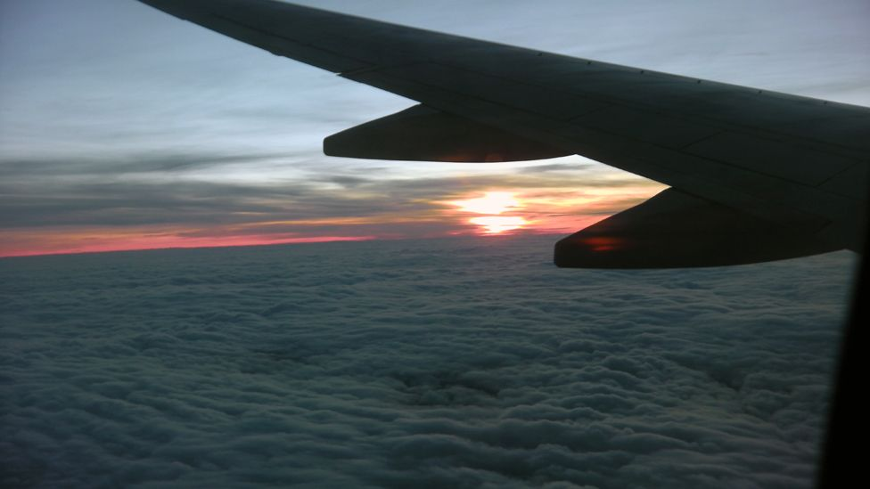 Sunset with a plane wing in the foreground