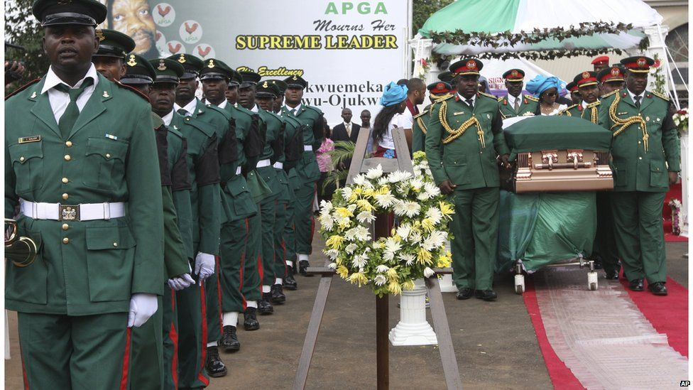 Soldiers stand guard next to the casket containing the body of Chukwuemeka Ojukwu