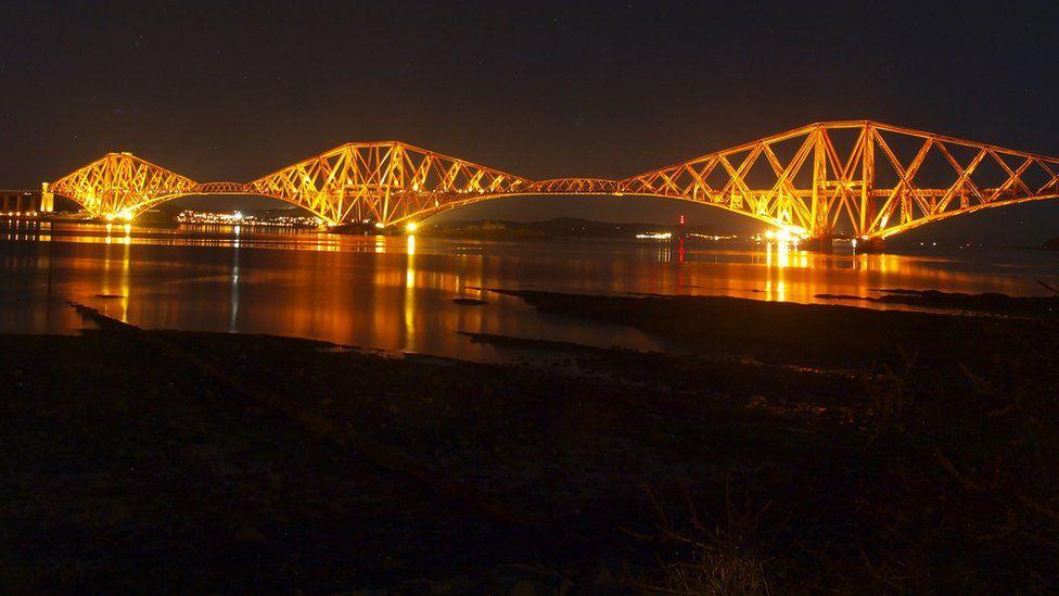 Forth Bridge illuminated at night
