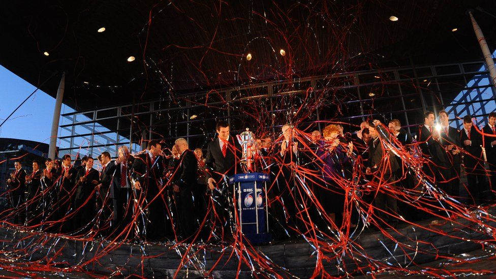The Wales team were showered with ticker tape after the re-presentation of the Six Nations trophy.