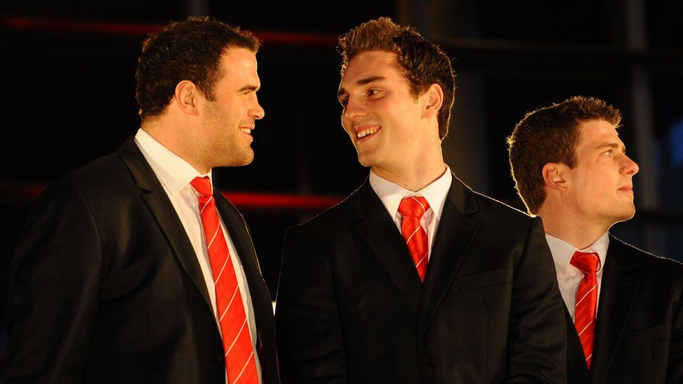 Wales centre Jamie Roberts and winger George North share a joke on the steps of the Senedd