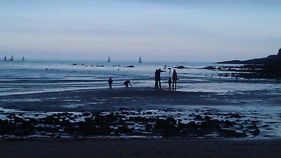 People on Stonehaven beach