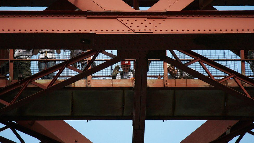 People standing on the Forth Bridge