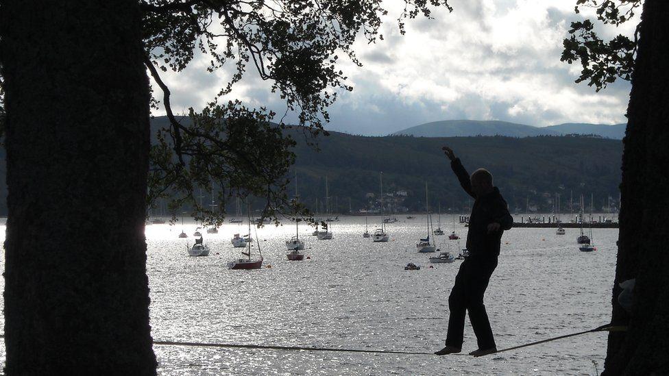 Man walking a tightrope