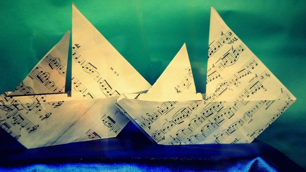 Paper boats made from sheets of music