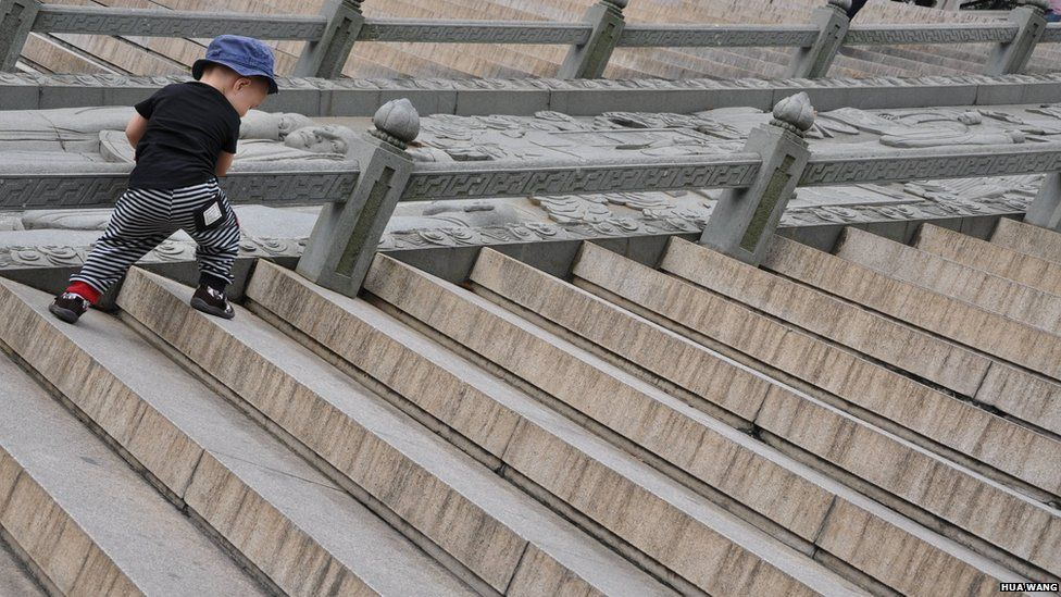 Boy climbing the stairs