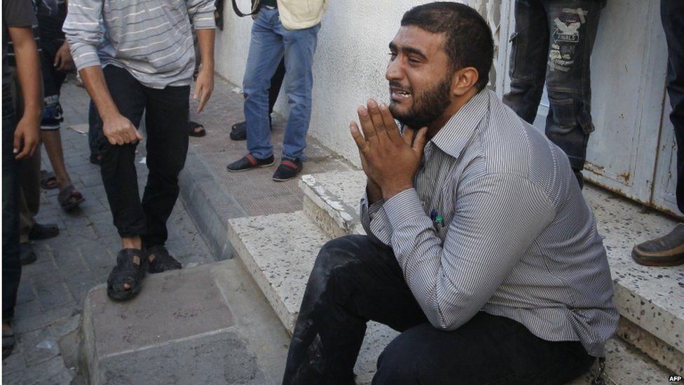 A Palestinian weeps outside the Shifa hospital.