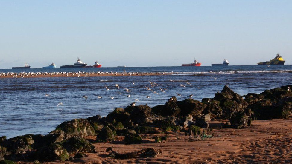 Boats in row at sea