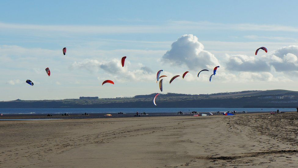 People flying kites