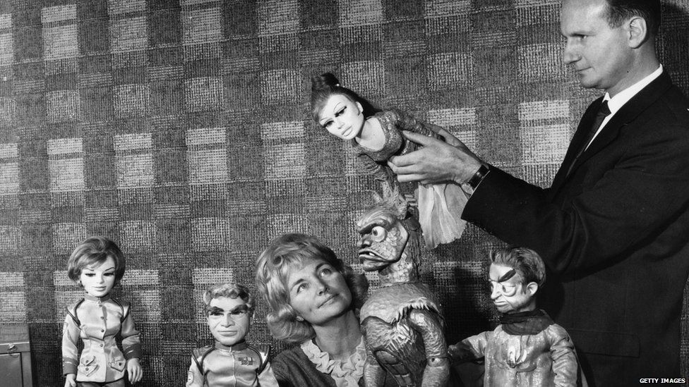 Co-founders of adventure series Stingray, Gerry and Sylvia Anderson with some of the puppets from the cast