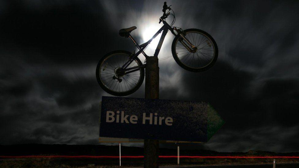 Bike illuminated by moonlight