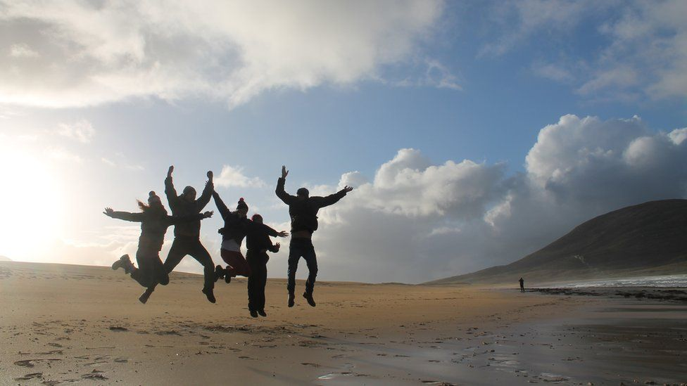 People jumping on the beach