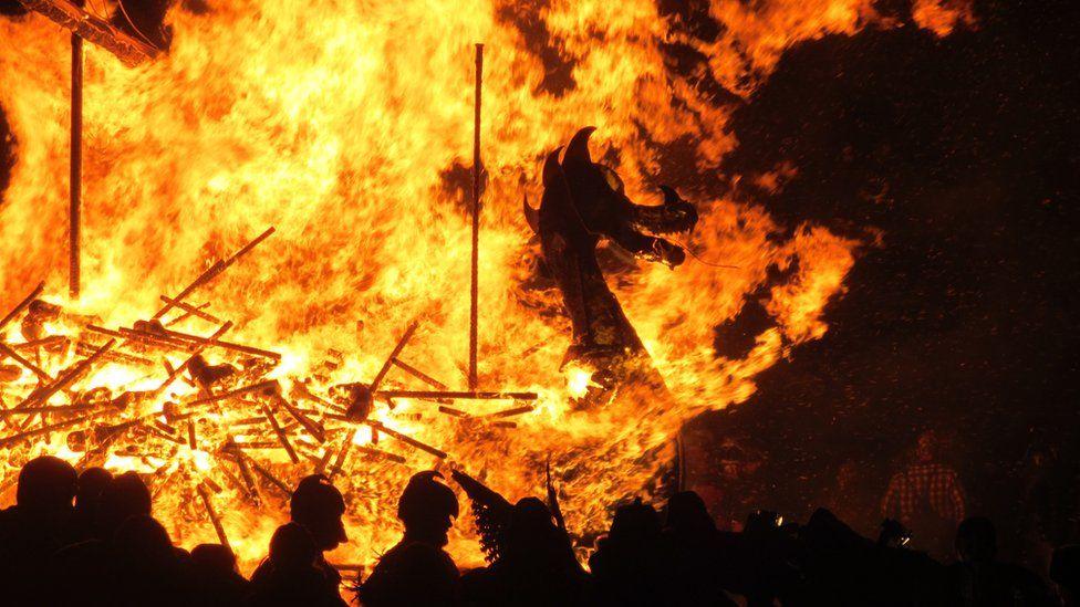 Viking longboat engulfed in flames