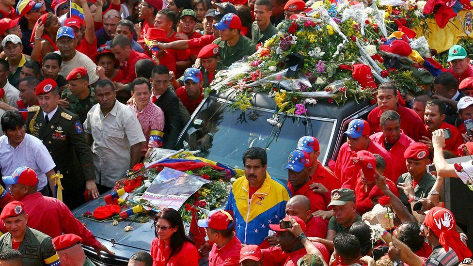 Bolivian President Evo Morales (far left) and Venezuelan Vice President Nicolas Maduro (centre) with procession carrying Mr Chavez's coffin