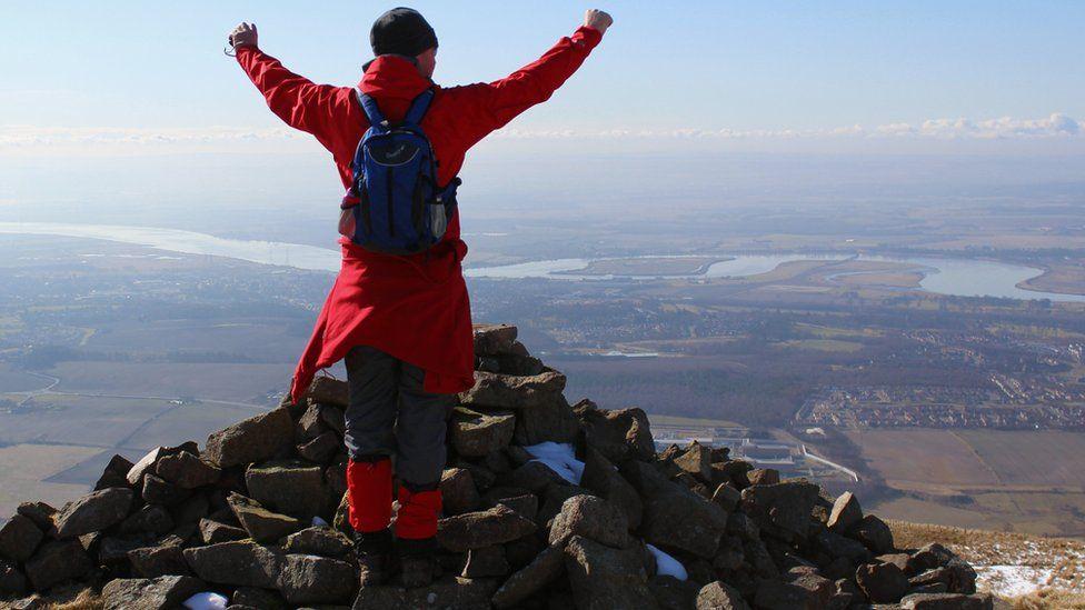 Man standing on top of Craig Elsie