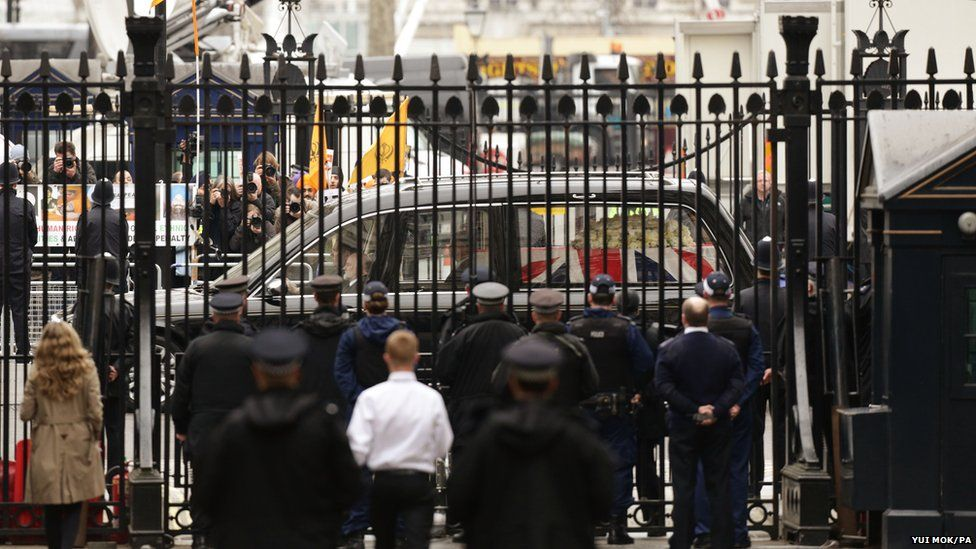A hearse carrying the coffin of Baroness Thatcher passes the gates of Downing Street