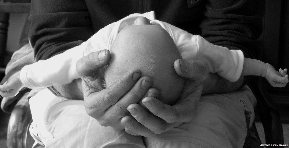Baby being held