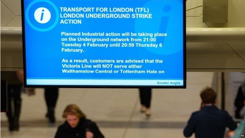 A screens flash up at Liverpool Street Station informing people of the strike