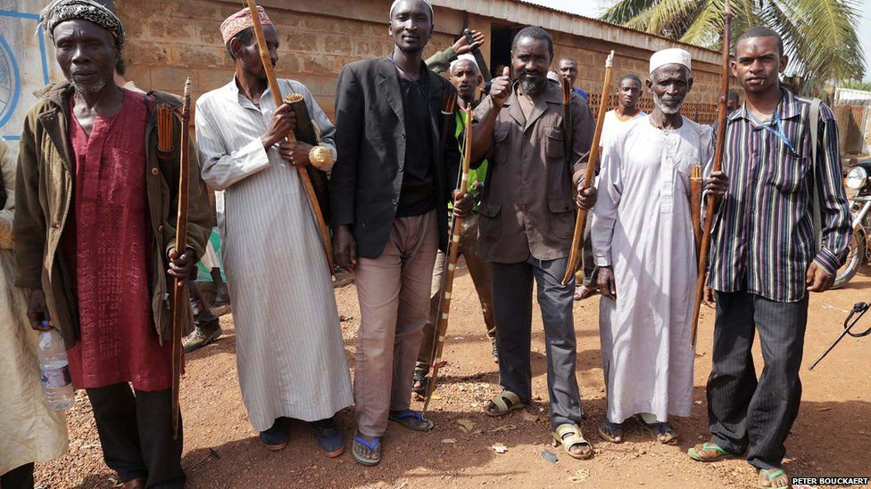 Muslim men with handmade bows and arrows in Boda - Central African Republic, February 2014