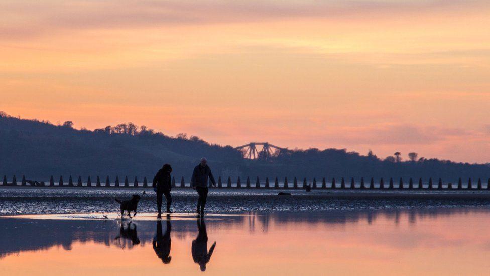 People walking on a beach