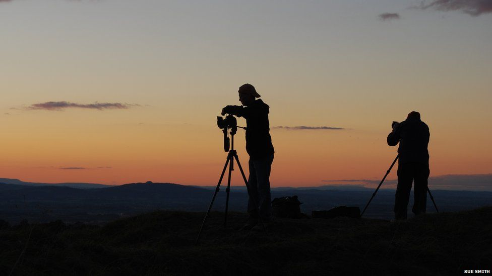 Photographers and a sunset