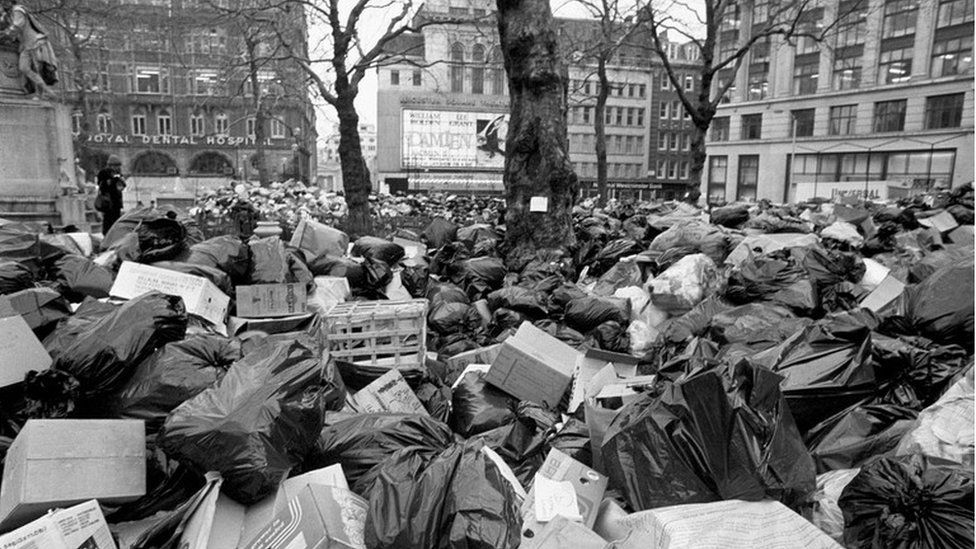 Rubbish piled high in Leicester Square, London