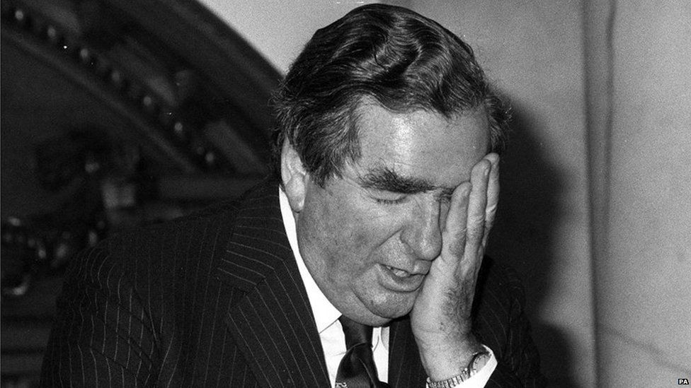 Denis Healey with his head in his hand