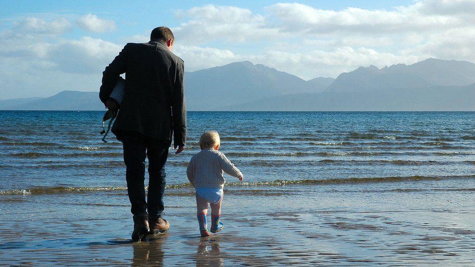 Elijah and his dad on Scalpsie Beach