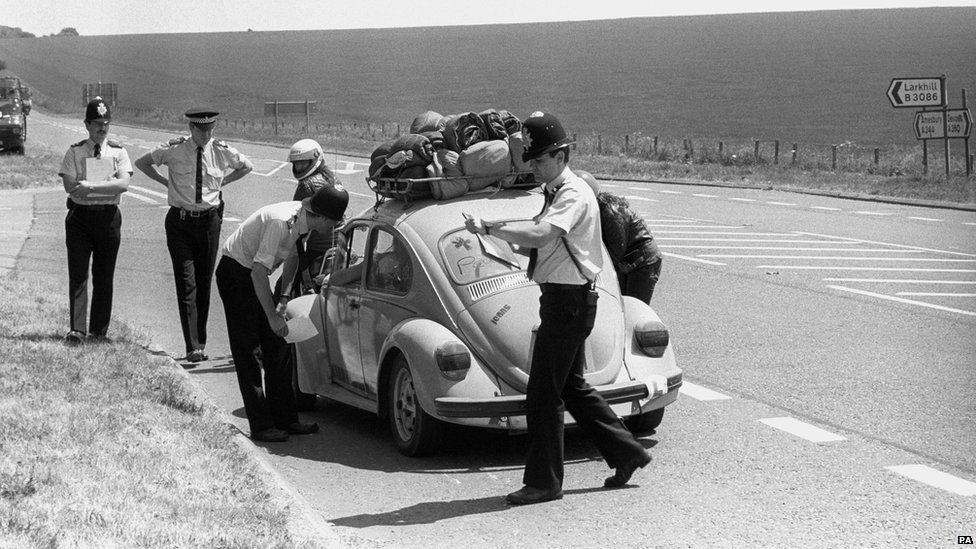 Police hand out keep-away leaflets as they turn away travellers bound for Stonehenge in an effort to stop hippies gathering at the monument to celebrate the summer solstice in 1989.