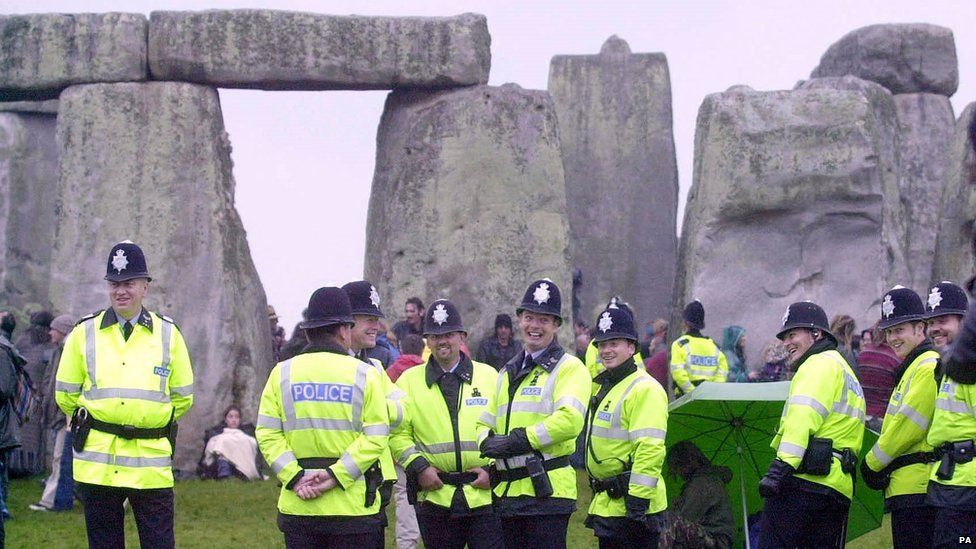 Police on duty for the summer solstice at Stonehenge in 2000.