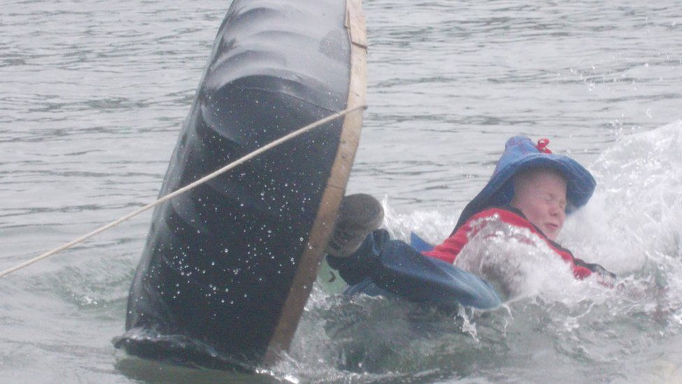 Boy falls overboard