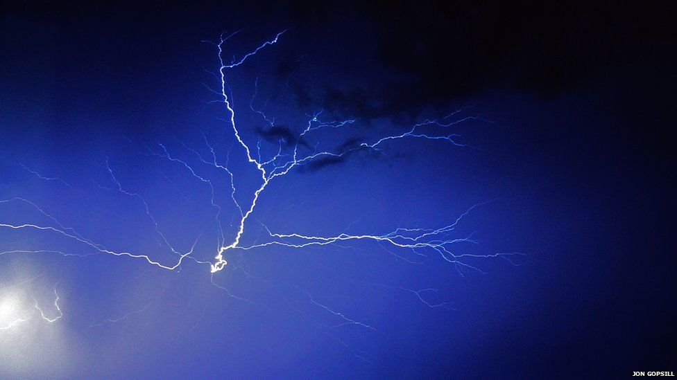 A fork of lightning in the sky at night