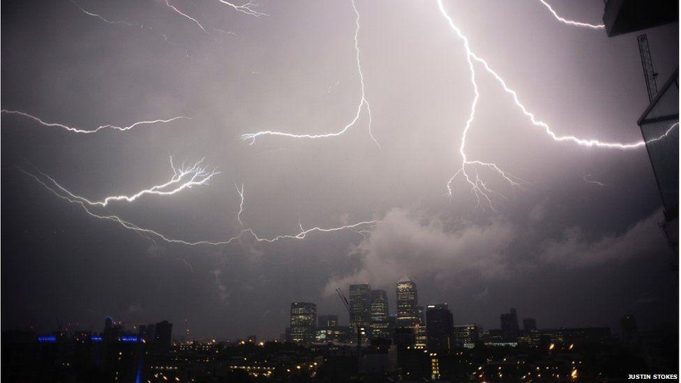 Lightning striking Canary Wharf at night