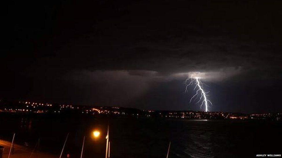 A lightning strike on a city at night