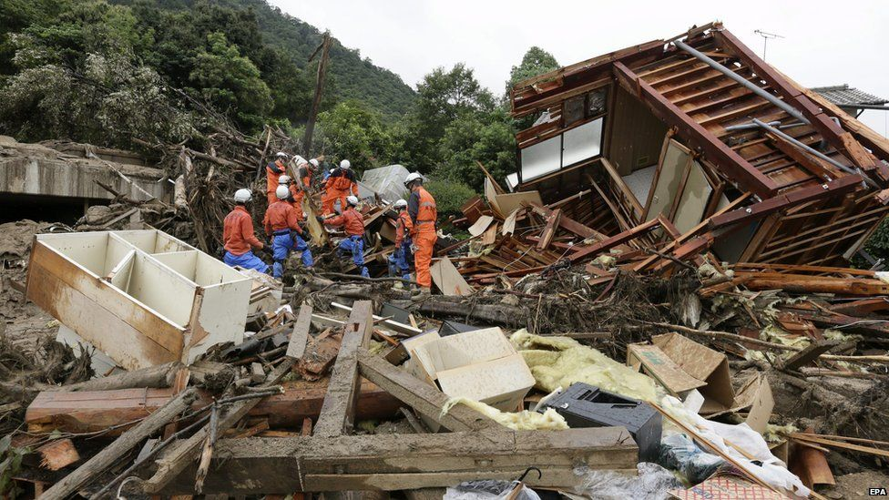 Rescue workers restart rescue operations at a landslide site in Hiroshima, Hiroshima Prefecture, western Japan, 22 August 2014